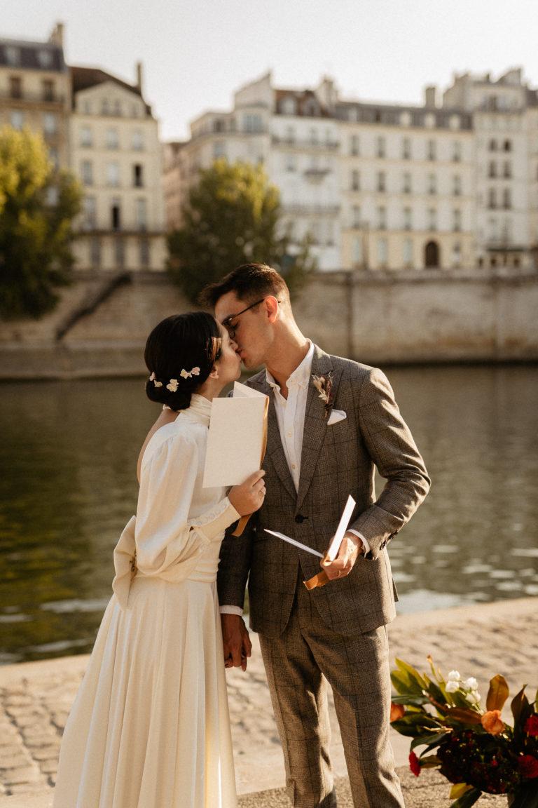paris elopement wedding vows exchange by the seine river