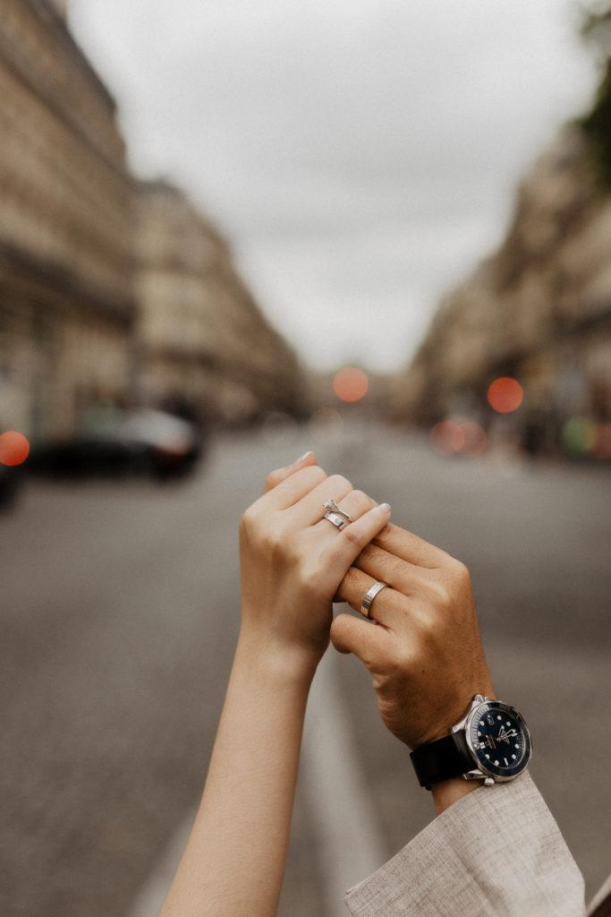 Couple holding hands Paris street backdrop