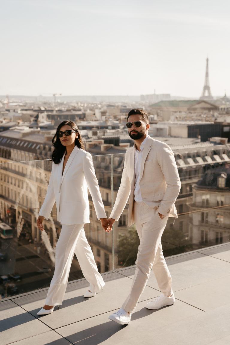 bride wearing suit paris wedding elopement eiffel tower view rooftop