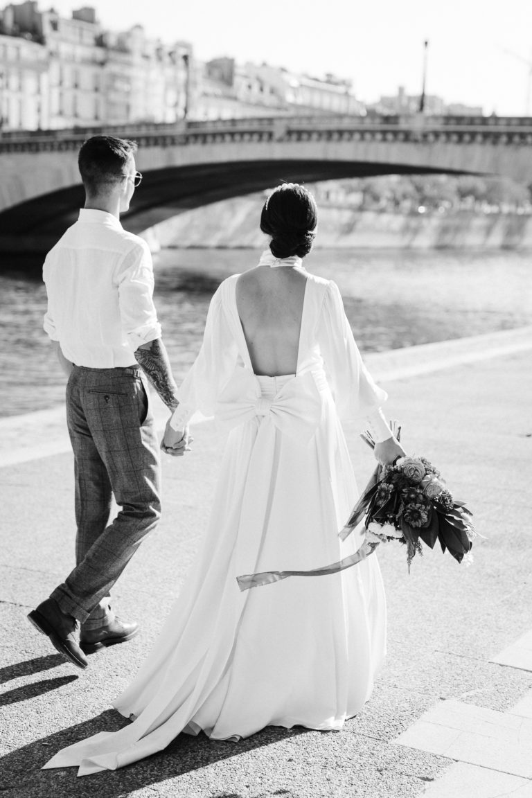 Paris Elopement By the seine black and white bride and groom