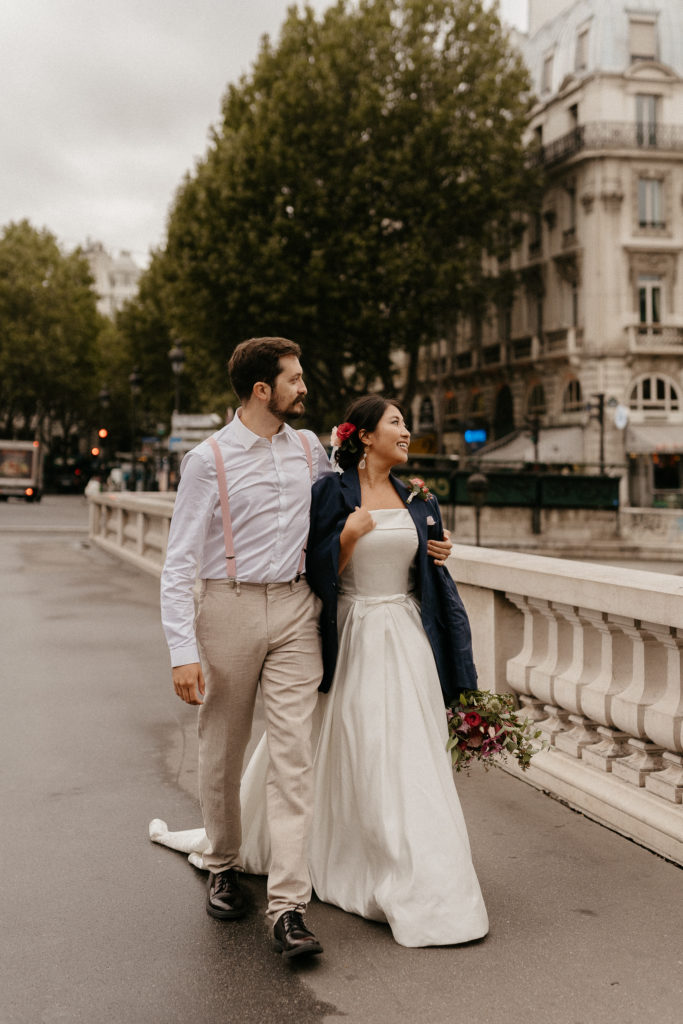 Couple in paris walking by the seine