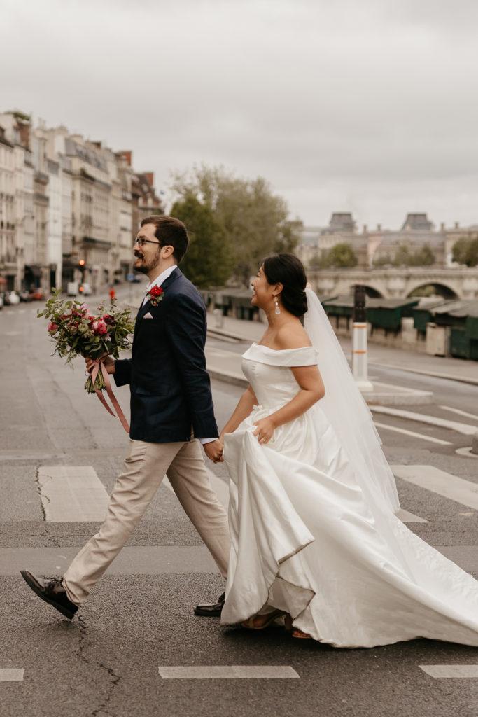 Paris elopement bride and groom walking along in Paris