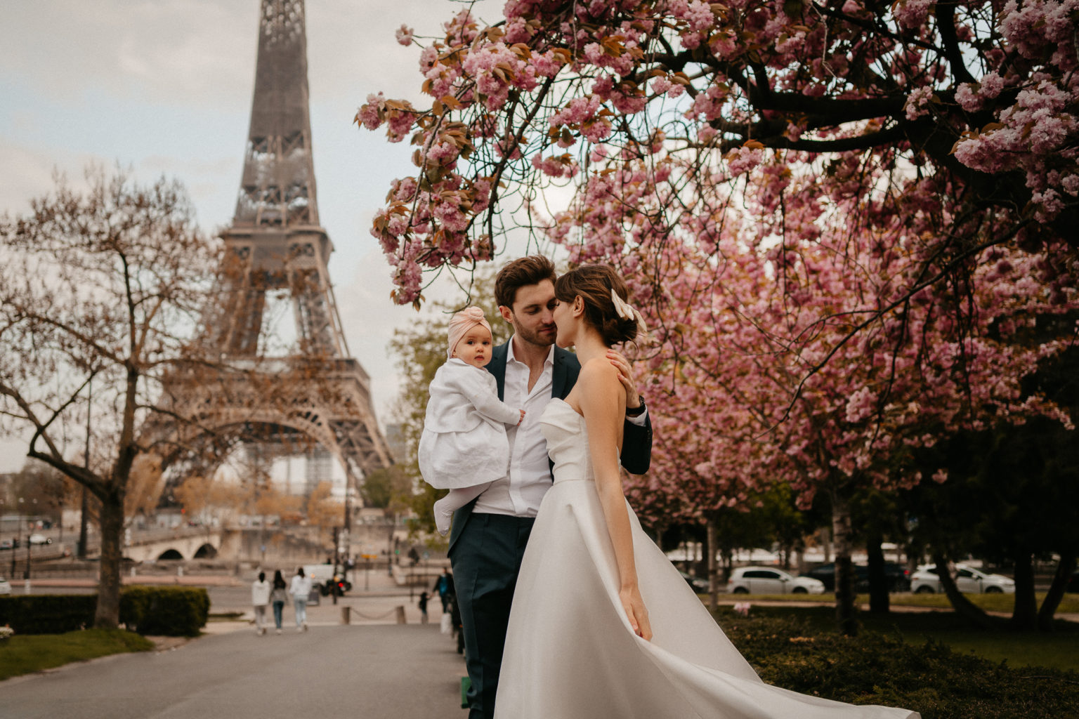family portrait by tour eiffel and cherry blossom