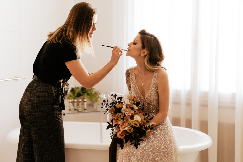 make up and hair stylist bridal preparation moment