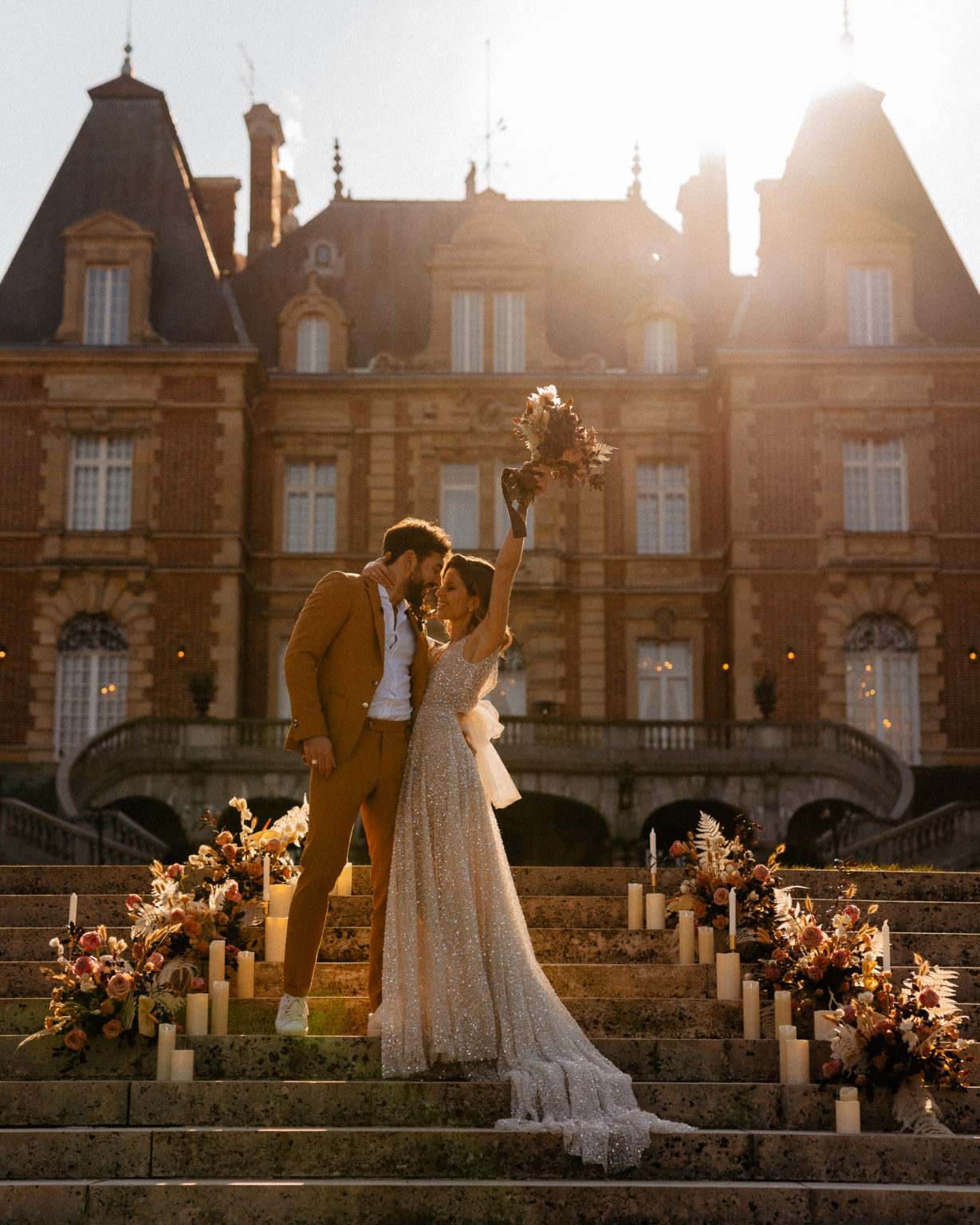 Elopement wedding in castle Bouffemont at golden hour of sunset